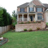 2 story brick house with beautiful lawn