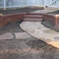 brickwallstonesidewalk