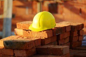 construction hat on brick wall